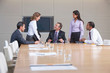 Businessmen and businesswomen having discussion in conference room