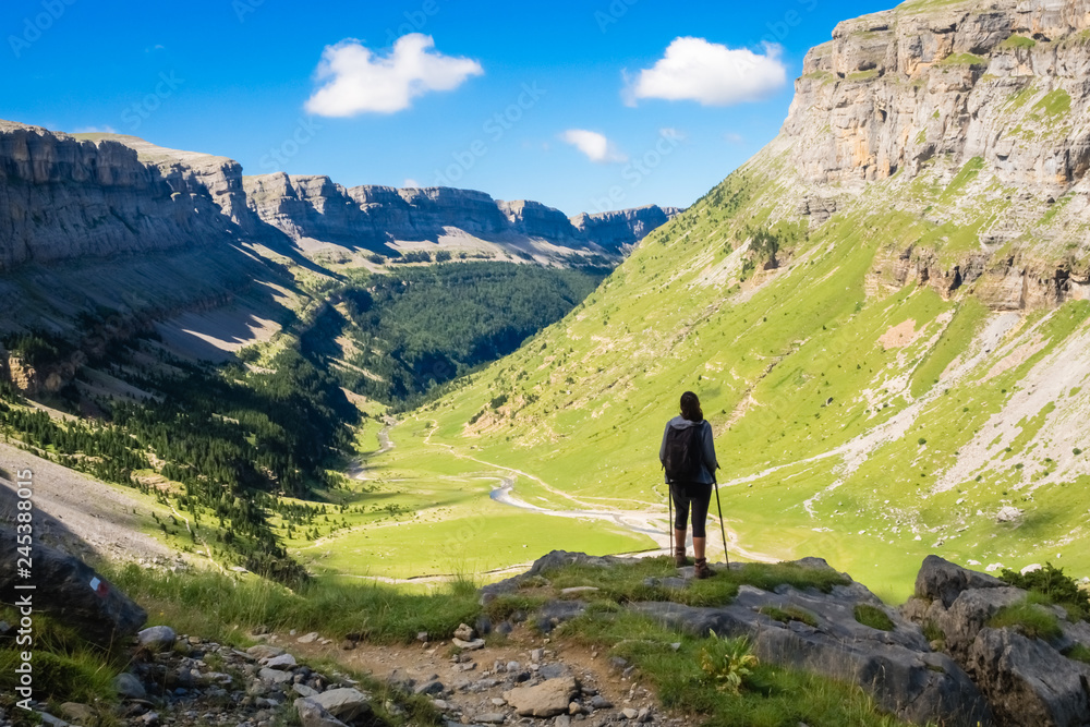 Fototapety, obrazy: Hiker looking towards the valley of the Ordesa National Park on a sunny day.  Spain