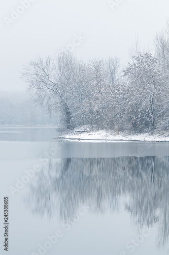Fototapety, obrazy: Winter lake scene reflecting in the water