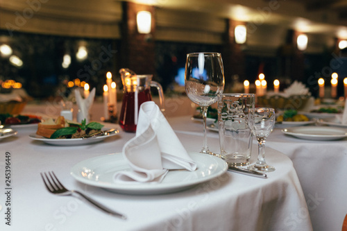 фотография  dinner set arranged on a table with vintage cream lace tablecloth and napkins, e