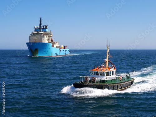 Harbour Pilot Boat underway escorting offshore vessel to harbour. Wallpaper Mural