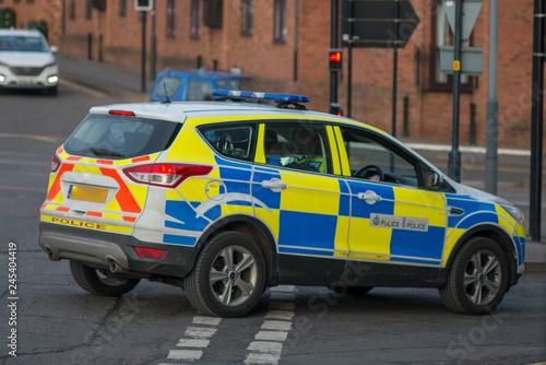 police car blocks road after skidding to a halt at major incident Canvas Print