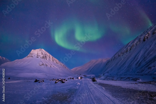 Montage in der Fensternische Aubergine lila The polar arctic Northern lights aurora borealis sky star in Norway travel Svalbard in Longyearbyen city the moon mountains