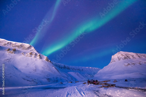 Poster Aurore polaire The polar arctic Northern lights aurora borealis sky star in Norway travel Svalbard in Longyearbyen city the moon mountains