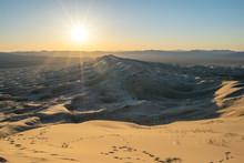 Sunset Sunburst Over Sand Dune...