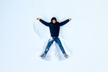 The Boy On A Snow Flapping Arm...