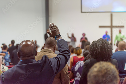 Fényképezés African American Man at Church with His Hand Raised