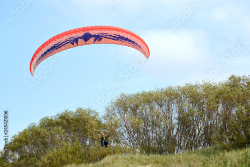 KALININGRAD REGION, RUSSIA. A paraplane wing in the sky over Curonian Spit