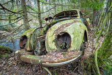 Old Car Scrap In Forest