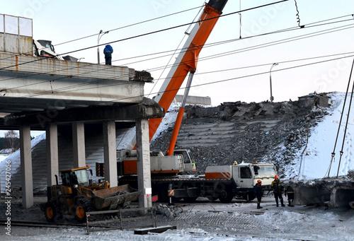 Lifting truck crane, dismantling a large reinforced concrete