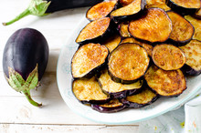 Fried Eggplant On A Plate On A Wooden Table