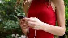 Girl With Smart Phone Enjoying...