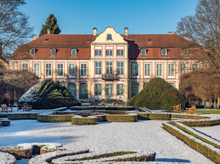 Abbots Palace built in the rococo style and located in Oliwa park. Winter scenery. Gdansk, Poland