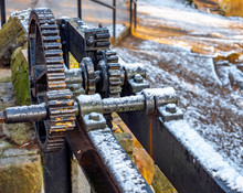 Gear Mechanism Of Small Sluice Lock Close Up, Cover With Snow.