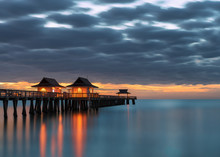 Reflections Of Naples Pier On The Gulf Of Mexico At Sunset From Naples, Florida