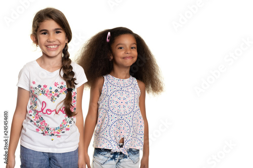 Foto  Hispanic and african american small girls  on a white background