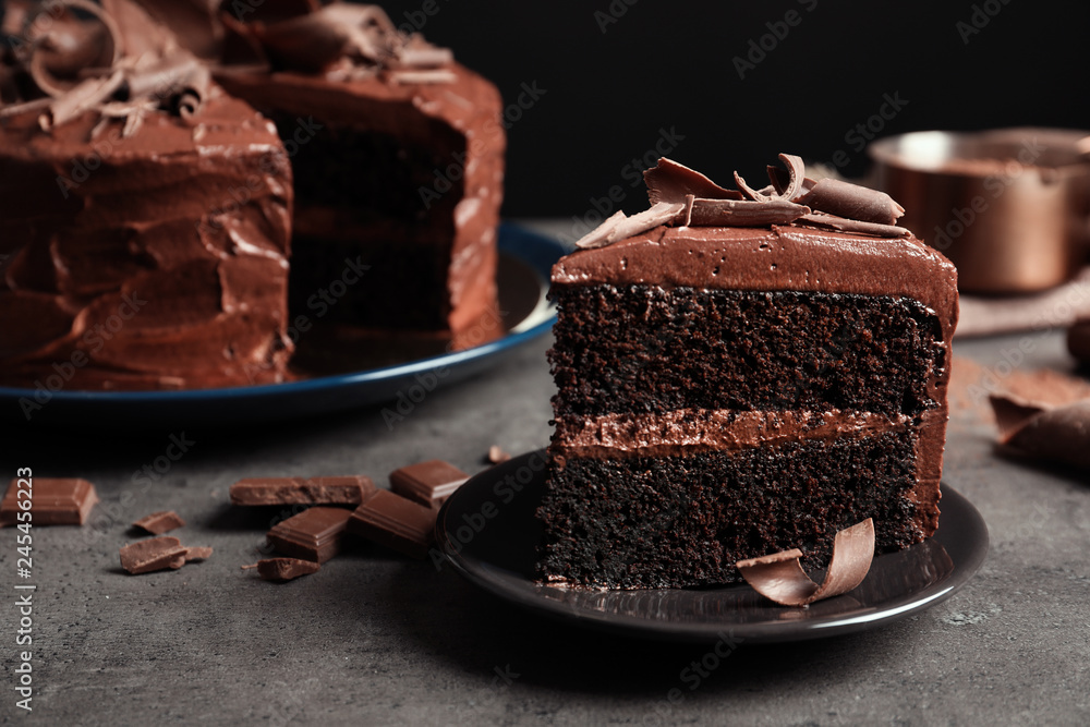 Fototapety, obrazy: Plate with slice of tasty homemade chocolate cake on table