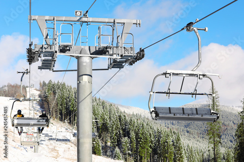 Chairlift at mountain ski resort. Winter vacation