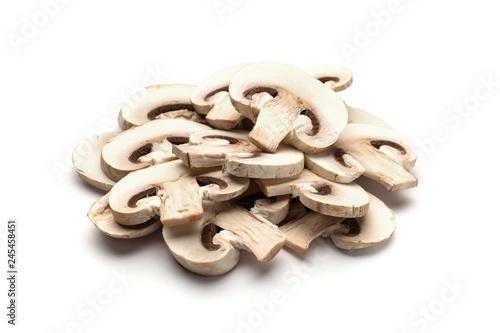 Slices of fresh champignon mushrooms on white background
