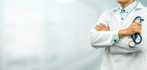 Male doctor standing in the hospital office. Medical healthcare and doctor service.