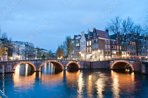 Poster Channel Keizersgracht inersection bridge view of Amsterdam canal and historical houses during twilight time, Netherland.
