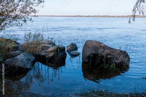 Basalt boulders on bank of  Amur River, below the village of Sikachi-Alyan Wallpaper Mural