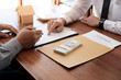 Business people signing contract making a deal with real estate agent Concept for consultant and home insurance concept.