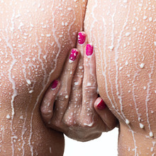 Attractive Naked Girl Enjoys A Spray With Milk. Spa Treatment For Skin Nutrition And Moisturizing Skin Renewal.