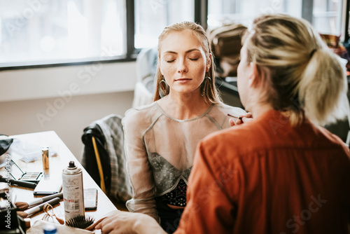 Model sitting down for her makeup Canvas Print