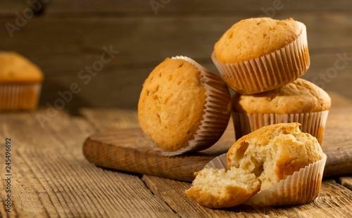 Fotografie, Obraz  Vanilla cupcake, homemade cakes on wooden background