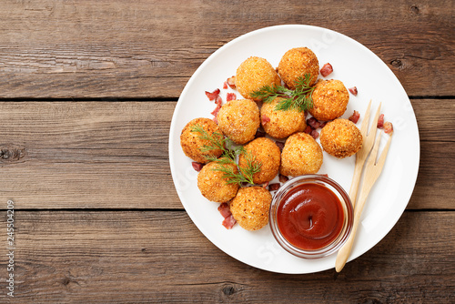 Fototapeta Potato croquettes - mashed potatoes balls breaded and deep fried, served with different sauce. obraz