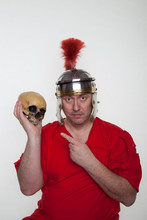 A Roman Soldier With A Human Skull
