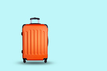 Travel Suitcase On Blue Backgr...