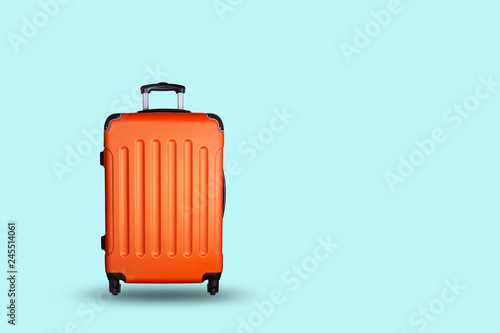 Fototapeta Travel suitcase on blue background