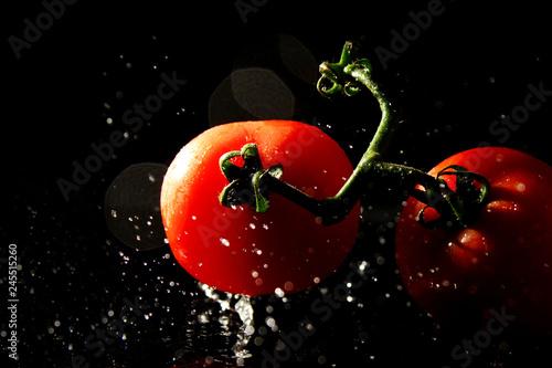 Vászonkép Fresh tomatoes as background / Fresh tomatoes on black background / Tomatoes are