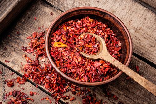 Staande foto Kruiderij Seasoning pepper sweet, red, sliced.