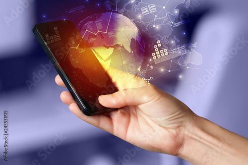 Photo  Hand using phone with global reports and stock market change concept