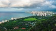 Timelapse of the city of Honolulu during the morning with rainy clouds and rainbow. Version with more ground in the frame. Hawaii
