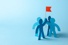Business Team And Red Flag With Goal. The Team Seeks To Achieve The Goal. Copy Space For Text.