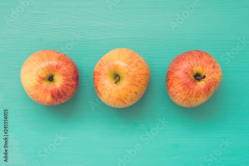 Fotografie, Obraz  Three fresh apples on wooden board, filter effect