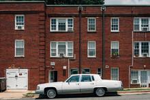 Vintage Car Outside A Brick Building In Alexandria, Virginia
