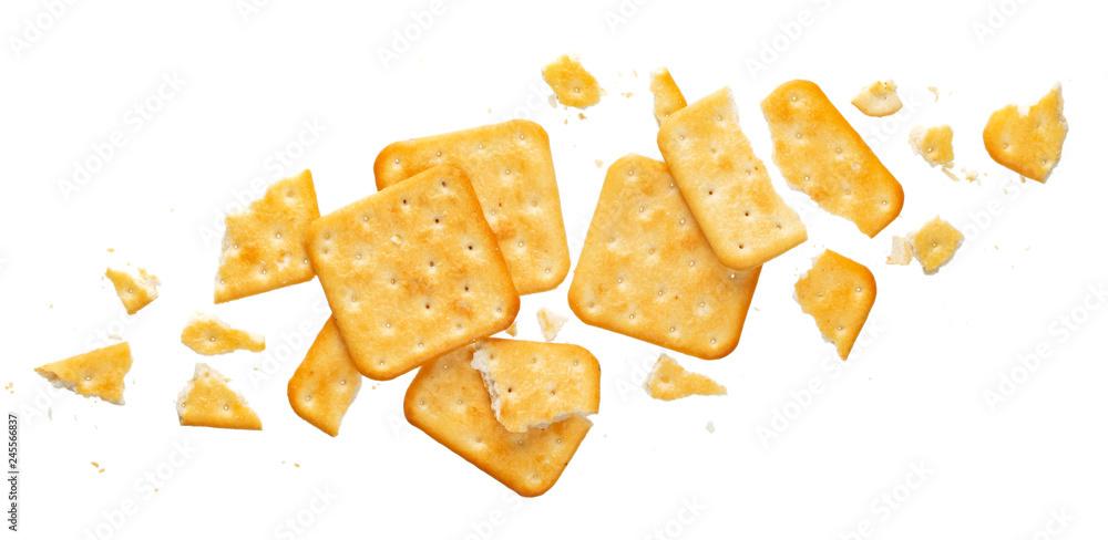 Fototapeta Broken cracker isolated on white background, top view