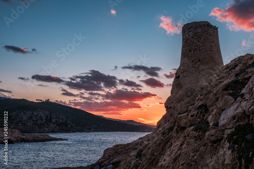 Valokuva  Sun setting behind Genoese Tower at Ile Rouse in Corsica