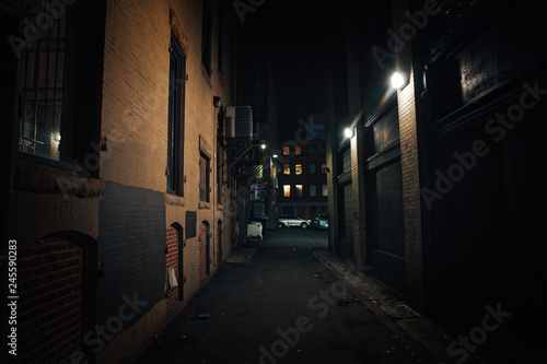 Fototapeta dark street. urban slums at night obraz