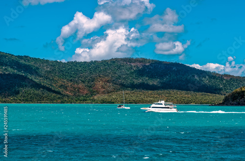 Boat in motion offshore from Airlie Beach in tropical, Queensland, Australia Wallpaper Mural