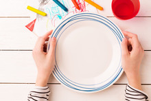 Table Setting For Kids - Empty Plate In Child's Hands