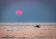 Couple  Kayak Sailing With Pad...