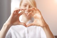 Blurred Woman Showing Hand Heart Gesture