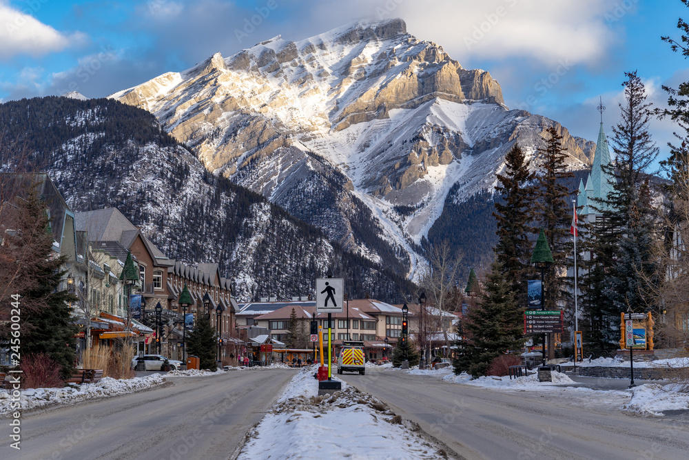 Fototapeta view of downtown Banff National Park, a Unesco World Heritage Site, during the winter. Cascade Mountain in background