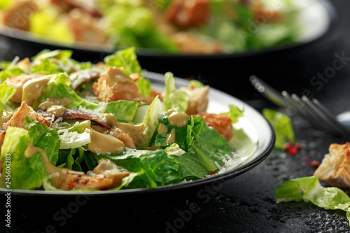 Fotomural Caesar salad with chicken, anchous fish, croutons, parmesan cheese and greens